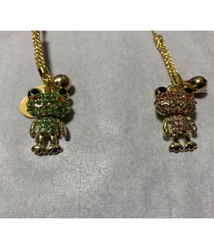 Amulet with a gold frog